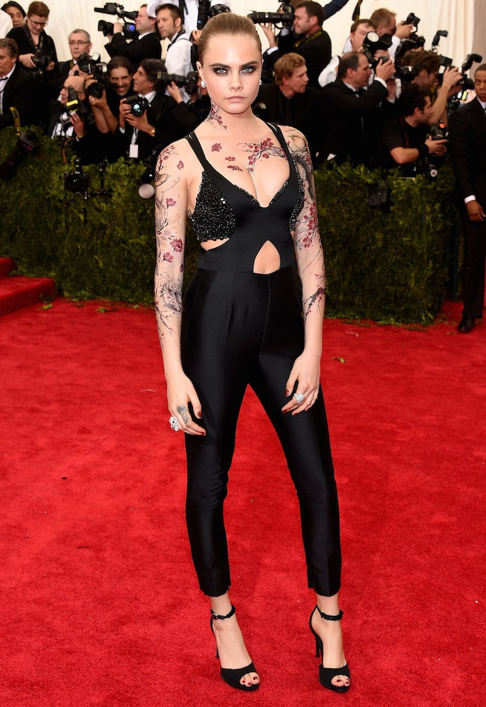 """NEW YORK, NY - MAY 04:  Cara Delevingne attends the """"China: Through The Looking Glass"""" Costume Institute Benefit Gala at the Metropolitan Museum of Art on May 4, 2015 in New York City.  (Photo by Larry Busacca/Getty Images)"""