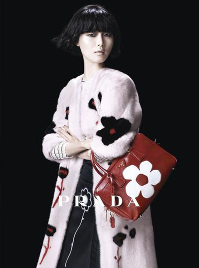 Sung Hee Kim - Ph: Steven Meisel for Prada SS13